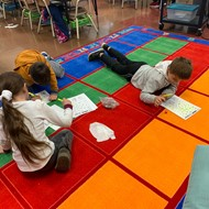 kids on new classroom rugs