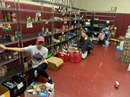 counselors packing boxes of food from pantry