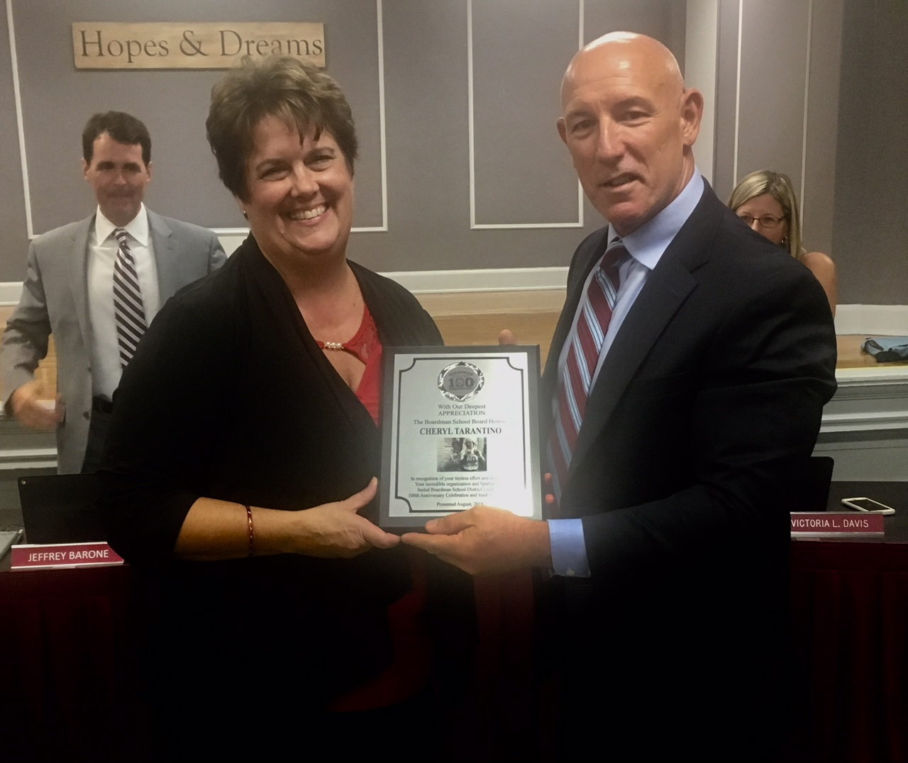 Alumni Association President Cheryl Tarantino Accepts Award from Superintendent Saxton