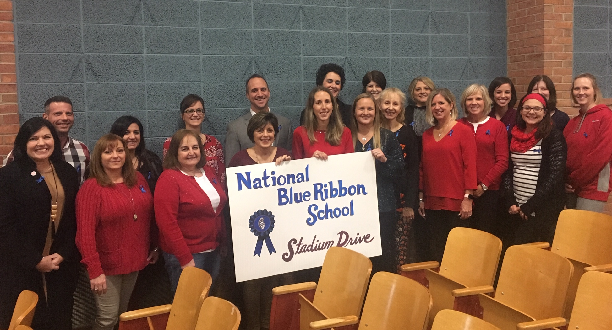 stadium drive staff holding sign with national blue ribbon school