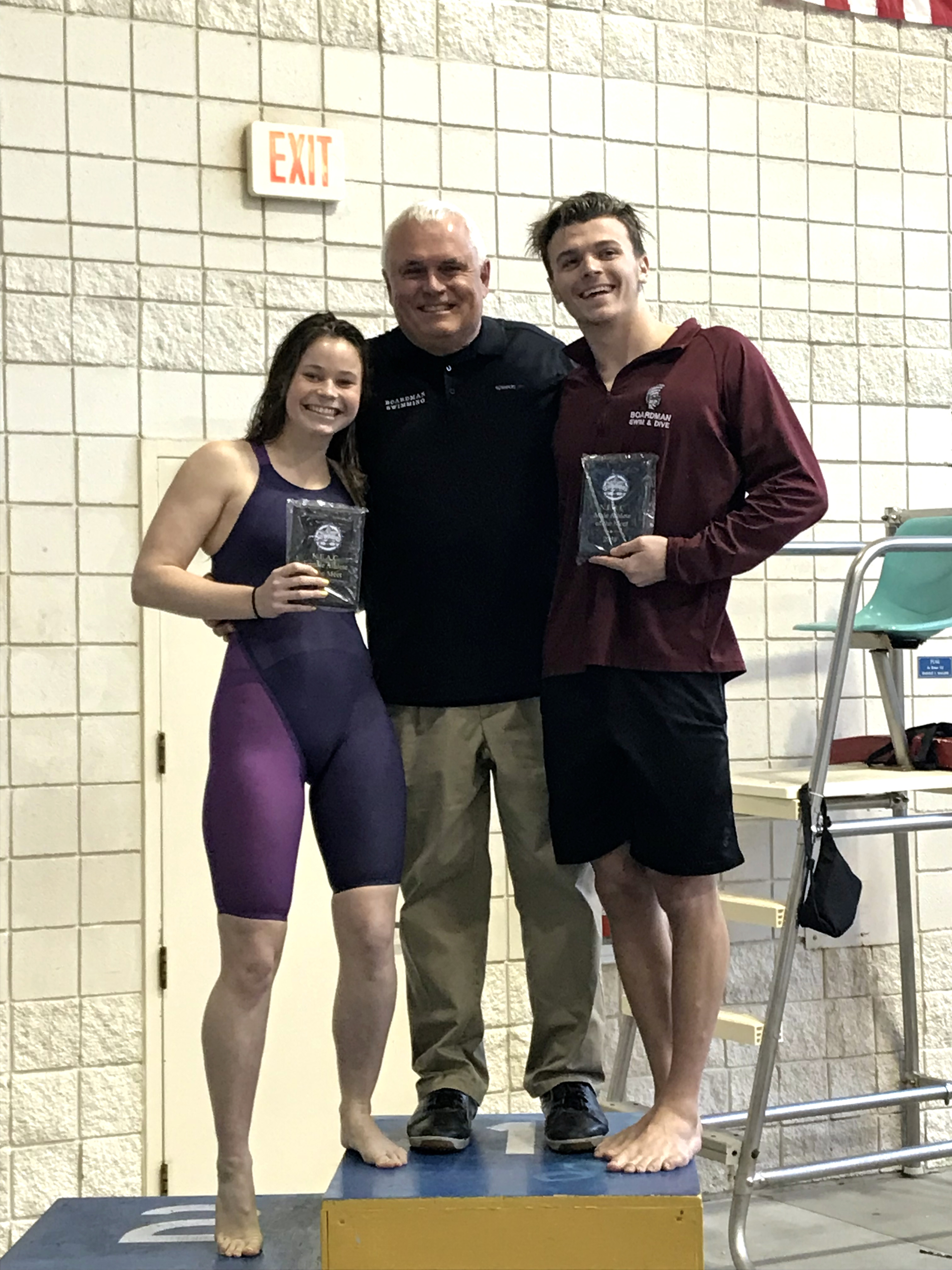 swim coach Terry O'Halloran with NEAC Meet MVPS Kyle Kimerer and Mikel Flatley