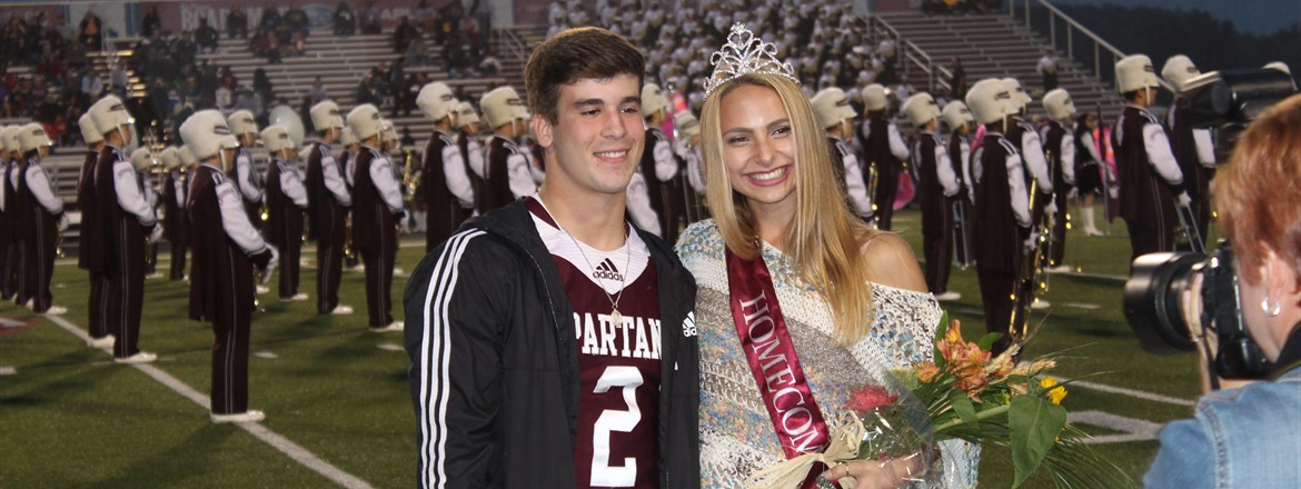 Homecoming Queen Cristina LaRoca with her escort Joe Ieraci in Spartan football jersey