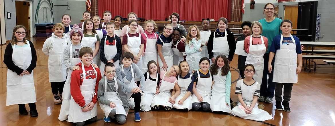 Tot chefs in aprons group picture in cafeteria
