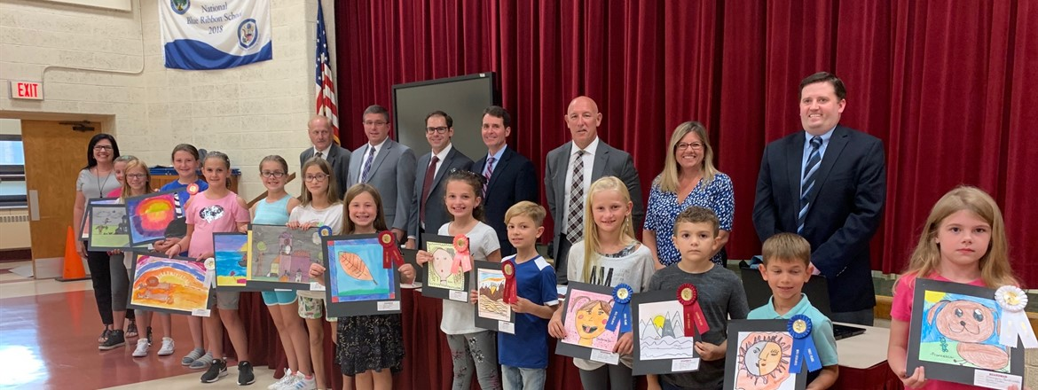K-4 elementary students with their art that was recognized by canfield fair