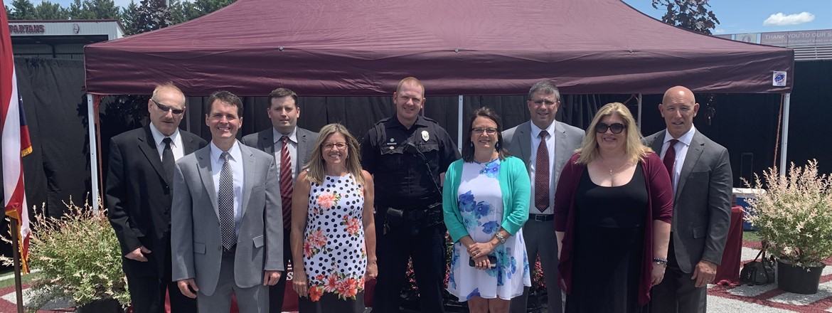 School Board, Principal Fernback, Superintendent Saxton, Officer Poulos, Asst. Principal Bott on field at Commencement