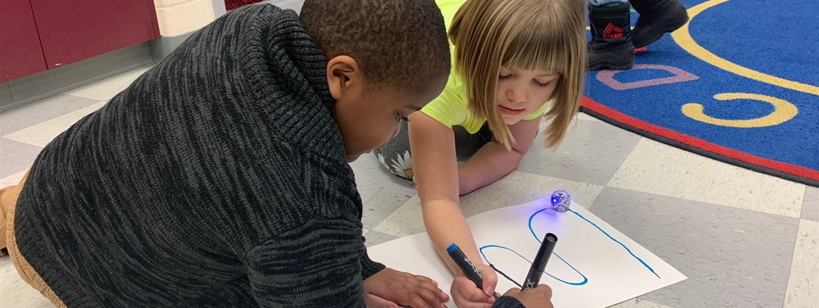 boy and girl using ozobots to set up coding sequence