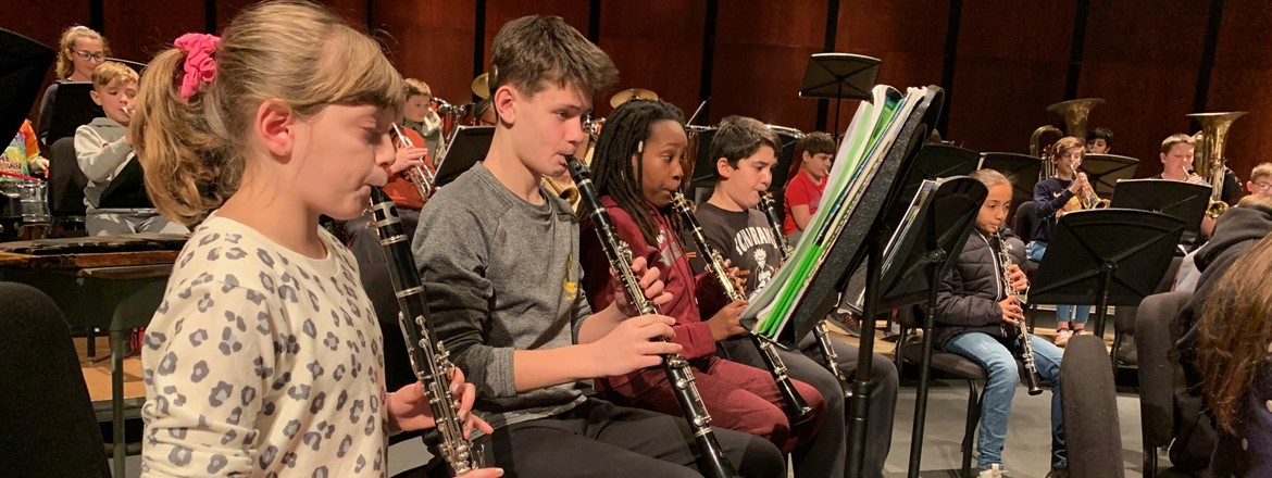 students playing clarinets with middle school orchestra on BPAC stage