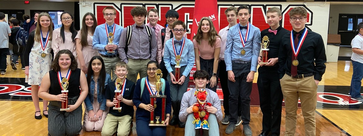 Two robotics teams pictured with medals and trophies at YSU competition