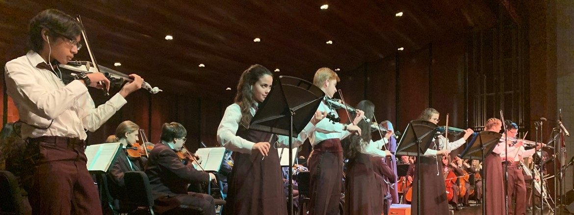high school orchestra violins on BPAC stage