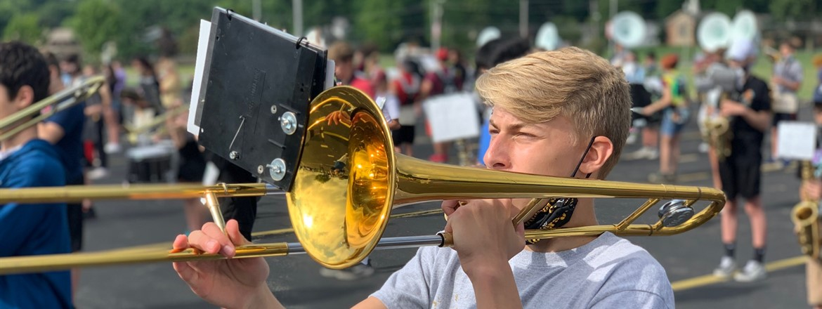 trombone player during practice outside