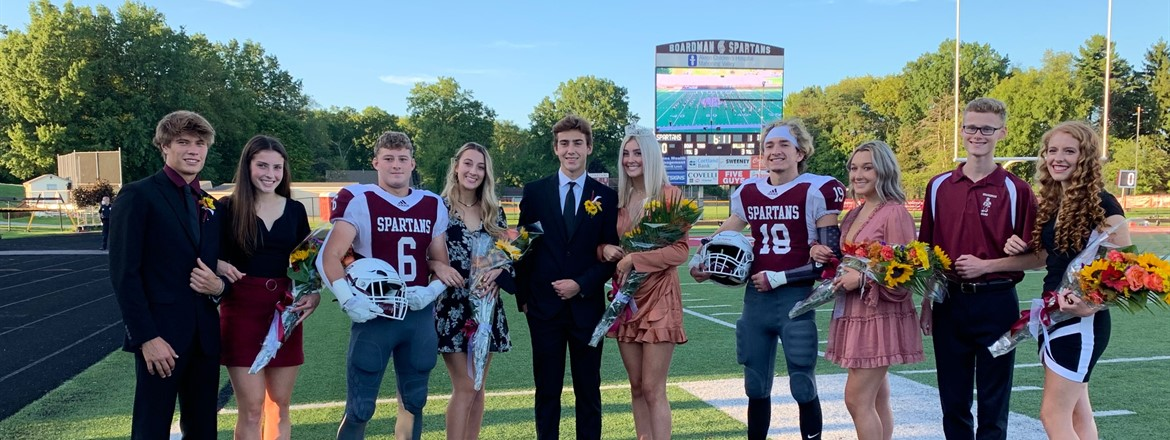 Homecoming Court on the field with their escorts