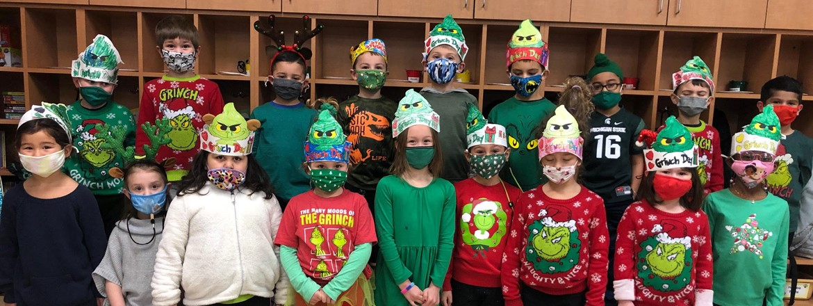 Kindergarten students decked out in Grinch attire, sweaters, hats, masks