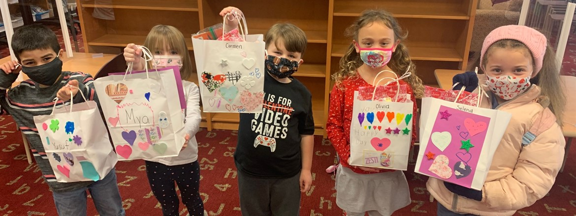 stadium drive students holding up valentine bags