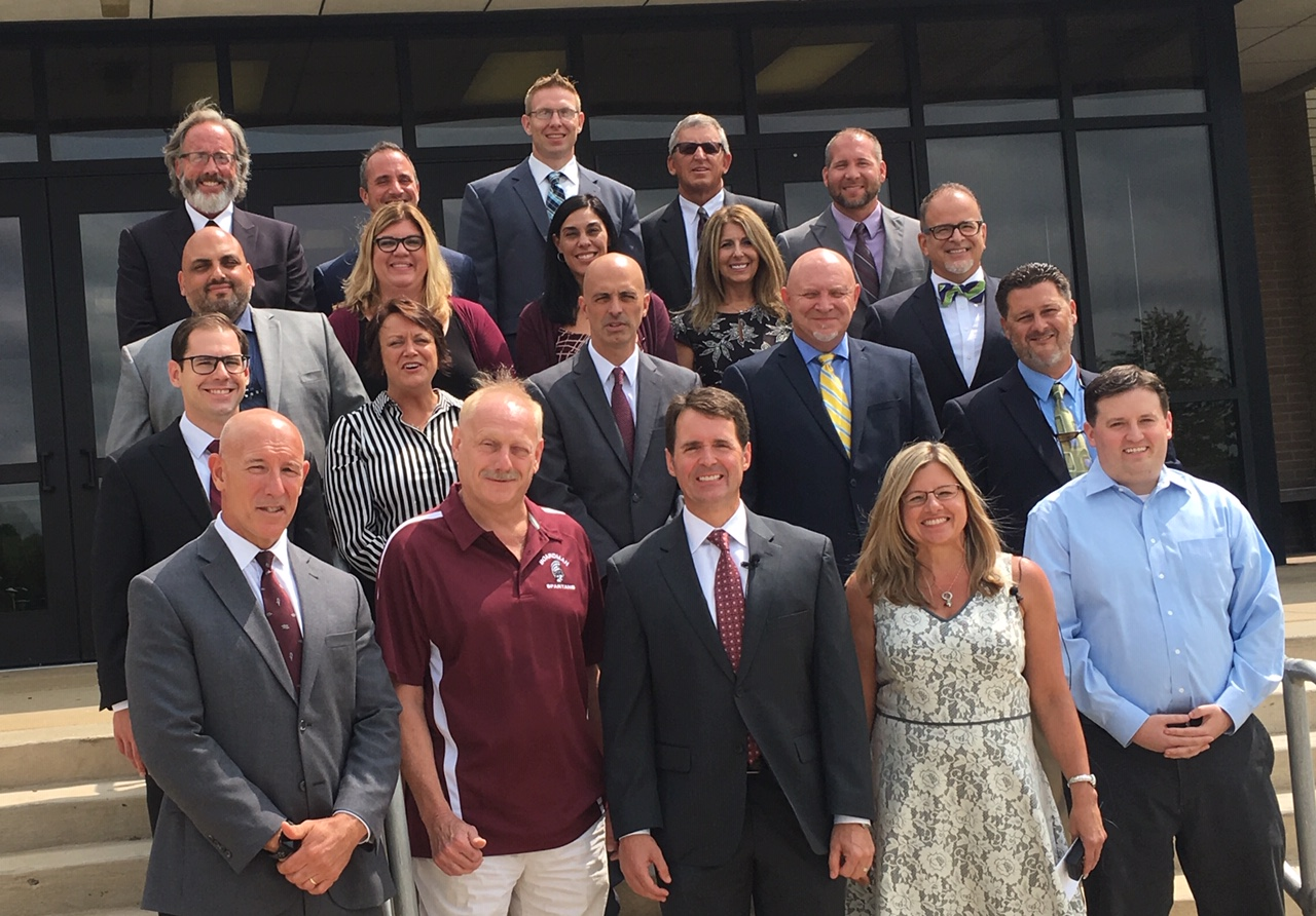 School Board, Central Office, Principals and Assistant Principals in front of High School
