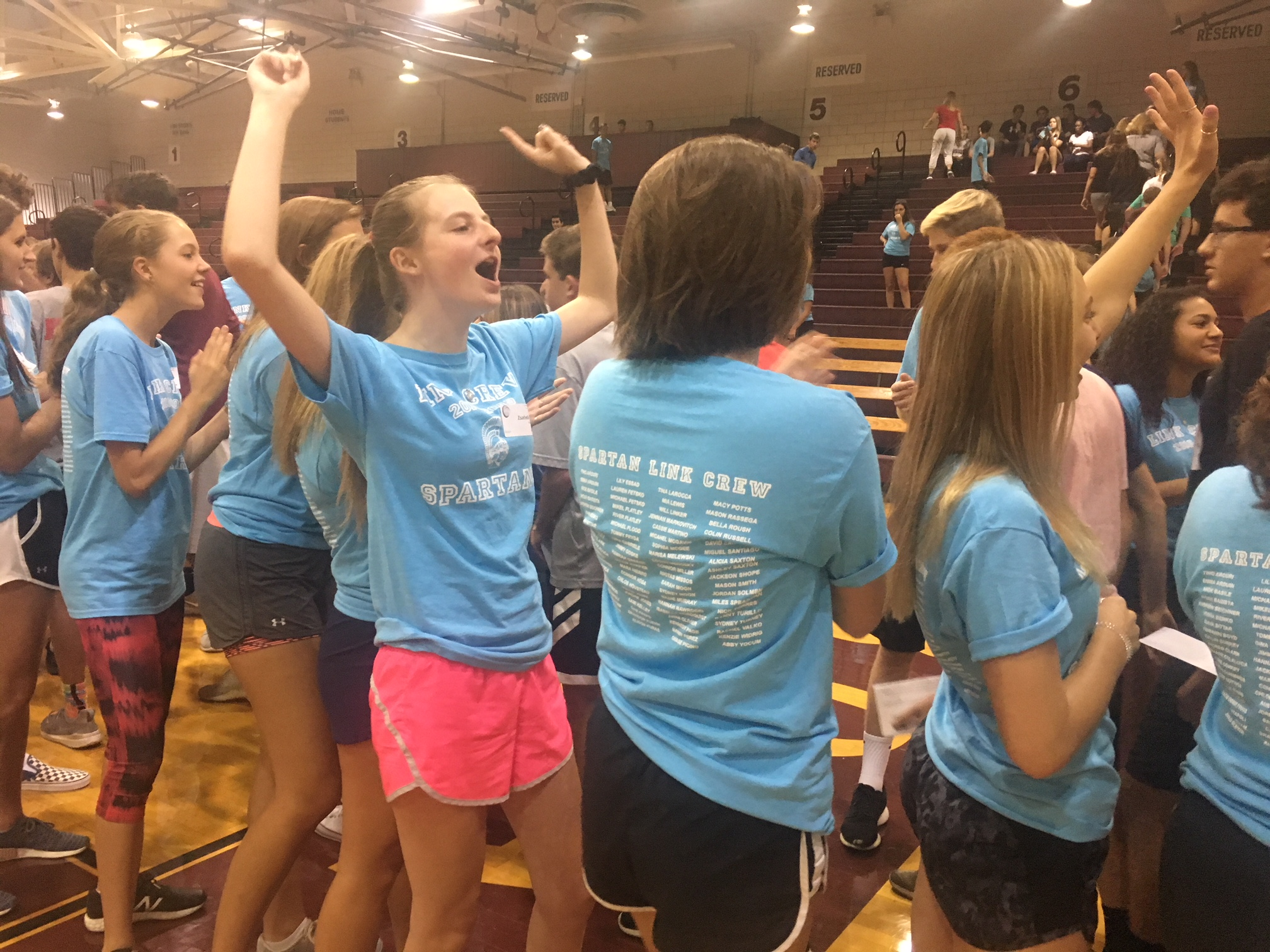 Link crew forms tunnel for incoming freshmen, and cheers them through